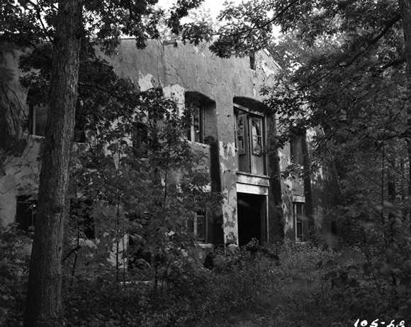 Burned out laboratory building on the Burnett estate. Photo taken in 1958, shortly before its demolition.